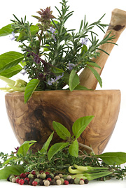 herbs in wooden bowl image